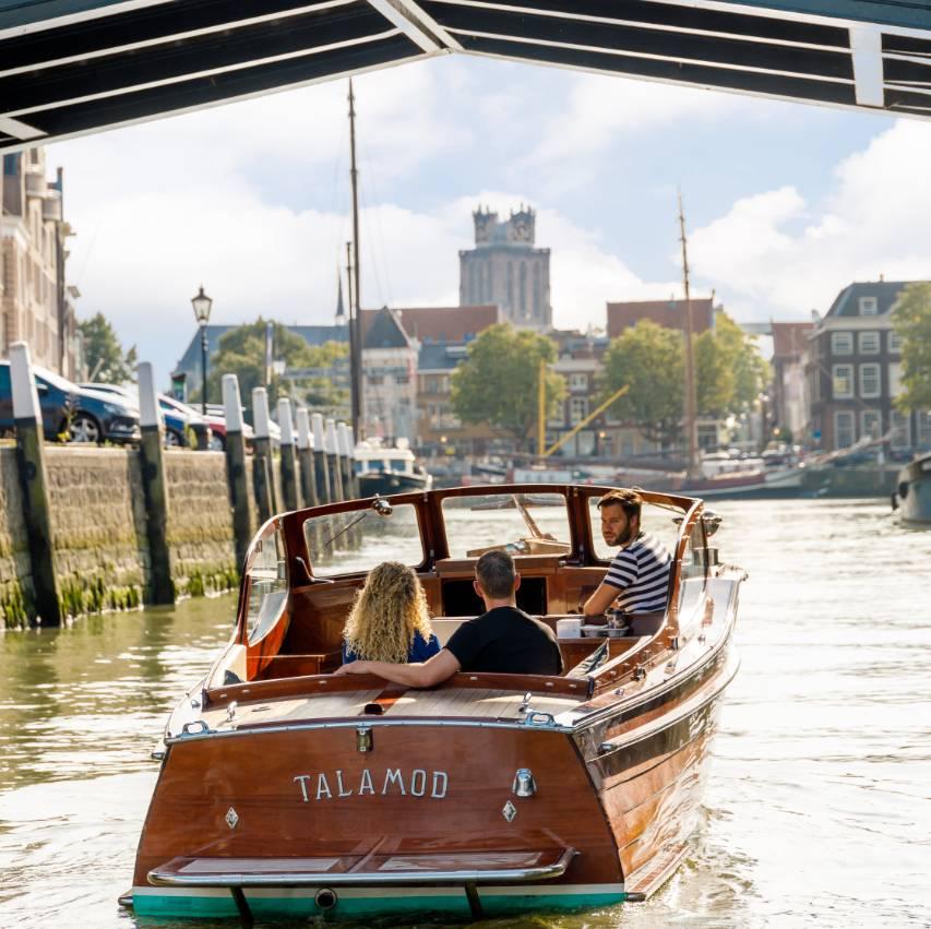 boat under bridge Dordrecht